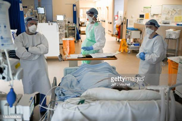 Staff at University Hospital Monklands attend to a Covid-positive patient on the ICU ward on February 5, 2021 in Airdrie, Scotland. The numbers of...