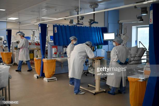 Staff at University Hospital Monklands attend to Covid-positive patients on the ICU ward on February 5, 2021 in Airdrie, Scotland. The numbers of...