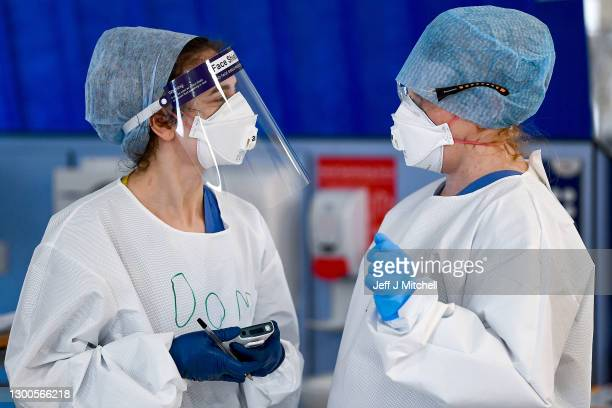 Staff at University Hospital Monklands converse on the ICU ward on February 5, 2021 in Airdrie, Scotland. The numbers of patients with Coronavirus at...