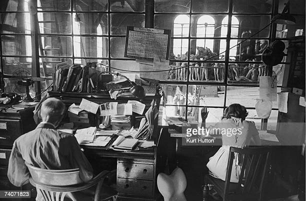Staff at work at Gems Ltd a factory in a disused chapel off Portobello Road London where wax and composition models are made for dress shops museums...