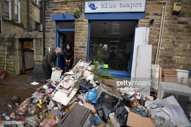 Staff beginning cleaning the Blue Tea Pot cafe as residents begin clearing up following severe flooding beside the River Calder on February 10 2020...
