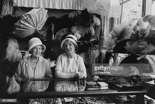 Staff behind the display counter at a shop selling jewellery and clothing in Portobello Road London circa 1969