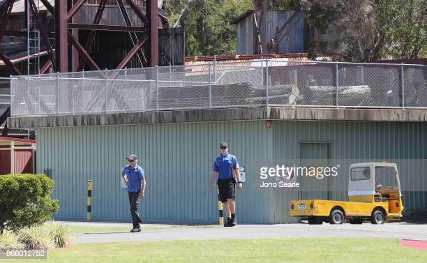 Staff can be seen near the closed Thunder River Rapids ride at Dreamworld on October 25 2017 in Gold Coast Australia Four people were killed...