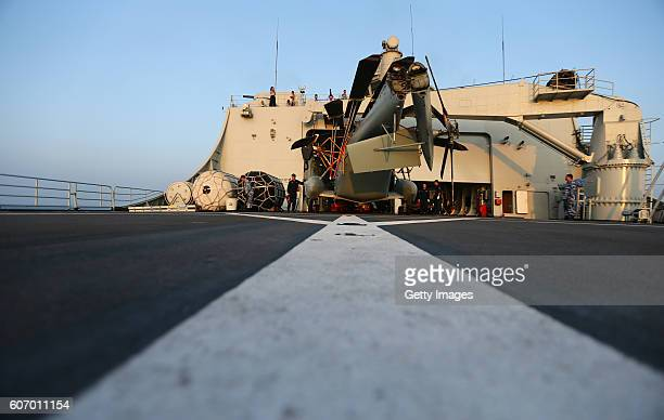 Staff check on helicopter before lifting off the Amphibious transport dock Kunlun Shan during ChinaRussia Naval Drill Joint Sea2016 on September 17...