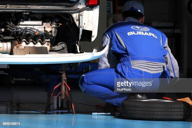 Staff checks Subaru's car collision test at its factory in Tokyo Japan October 30 2017 Subaru is latest big Japanese company to admit mistake Company...