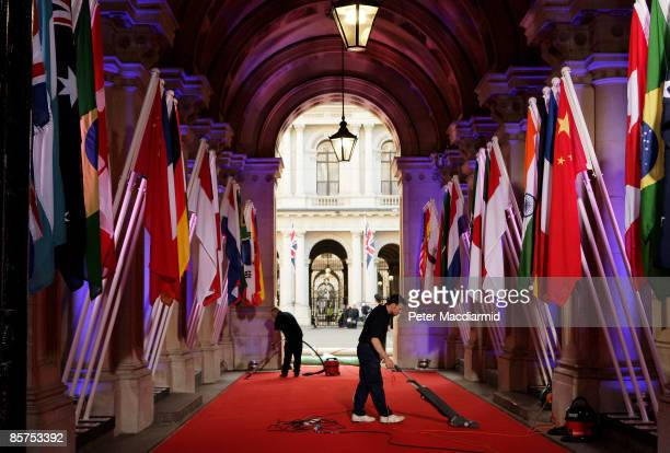 Staff clean the red carpet that G20 delegates will walk down at Downing Street for dinner on April 1, 2009 in London, England. President Barack Obama...