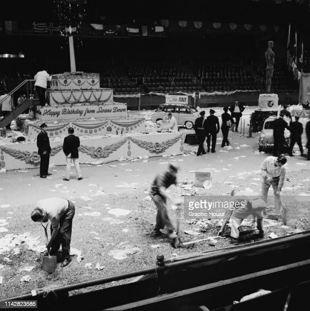 Staff cleaning up after Mike Todd's birthday party at Madison Square Garden, New York City, US, 18th October 1957.