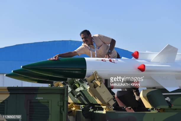 A staff cleans Akash a mediumrange mobile surfacetoair missile defense system developed by the Defence Research and Development Organisation on the...