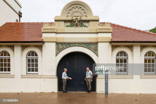 Staff close the main gate at Taronga Zoo on March 25, 2020 in Sydney, Australia. Taronga Zoo has temporarily closed its doors to the public to help...