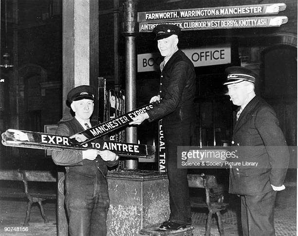Staff collect finger boards after the last train Lord Street Station Southport c 1952 The station closed 7 January 1952