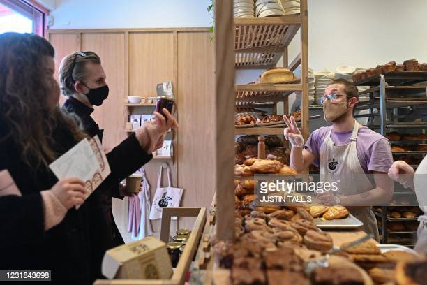 Staff deliver orders at the Sourdough Sophia bakery in north London on March 18, 2021. - When Britain first entered lockdown in March last year,...