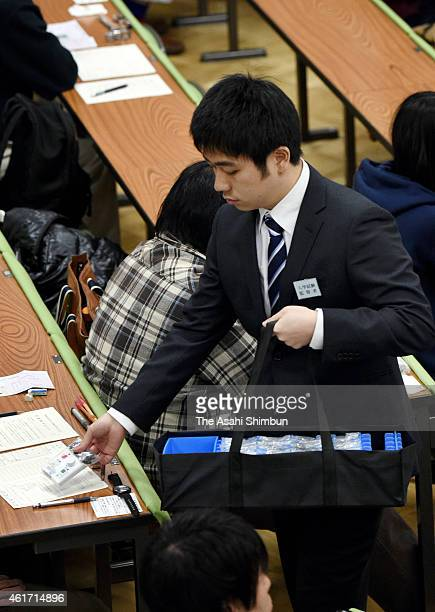 Staff distrubutes devices for the English listening during the national center exams at Tokyo University on January 17, 2015 in Tokyo, Japan. 559,132...
