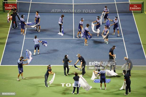 Staff dry court with towels during day one of the Rakuten Open at Ariake Coliseum on October 2 2017 in Tokyo Japan