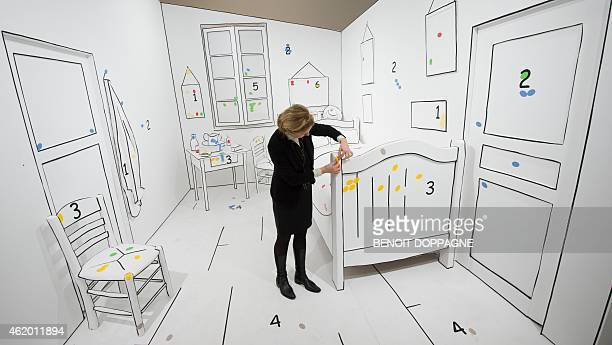 Staff fix details on January 23 2015 during the opening of an exhibition of works of Dutch painter Vincent Van Gogh called Van Gogh au Borinage at...