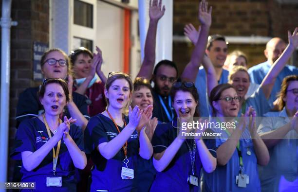 NHS staff from Dorset County Hospital applaud at the entrance of the Emergency Department on April 02 2020 in Dorchester United Kingdom The Clap For...