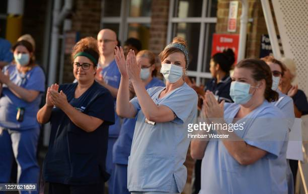 Staff from Dorset County Hospital applaud on May 28, 2020 in Dorchester, United Kingdom. For 10 weeks, the public have applauded NHS staff and other...