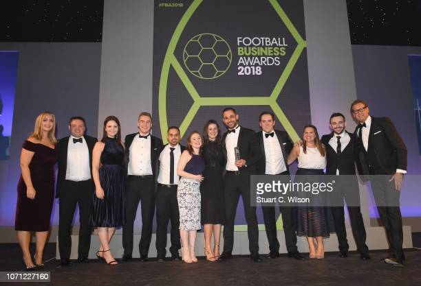 Staff from 'Everton In The Community' Winners of the 'Best Corporate Social Responsibility Scheme' award on stage with Hayley McQueen and Ed...