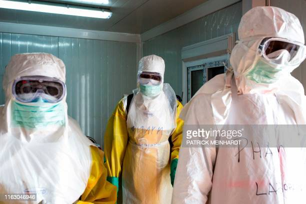 Staff from South Sudan's Health Ministry carry out a safety check of protective gear during a drill for Ebola preparedness conducted by the World...