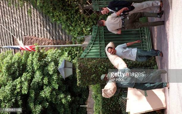 Staff from the Bekins moving company hired by the Los Angeles County Sheriff carry OJ Simpson's belongings from his Brentwood home 28 March in...
