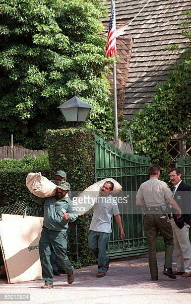 Staff from the Bekins moving company hired by the Los Angeles County Sheriff carry OJ Simpson's belongings from his Brentwood home 28 March in CA...