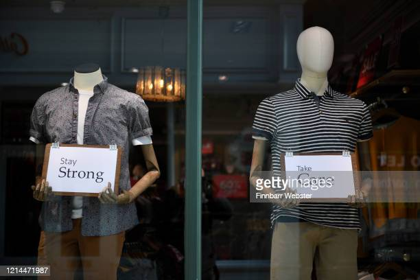 Staff from the closed White Stuff fashion store leaves messages for passersby on March 24, 2020 in Bournemouth, United Kingdom. British Prime...