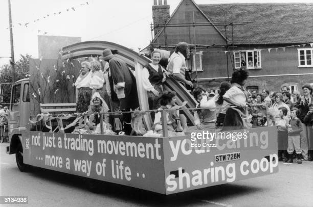 Staff from the Cooperative shop in the village of Tollesbury Essex join up with members of the CoOperative Folk Dance Club to parade a float down the...