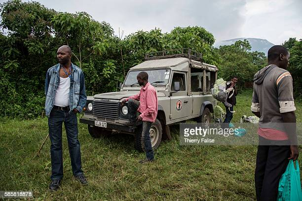 Staff from Virunga National Park stand near a jeep at the starting base for the walk to the top of Mount Nyiragongo The Nyiragongo is an active...