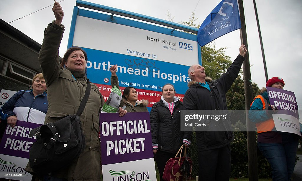 NHS staff gather at a picket line outside Southmead Hospital on October 13, 2014 in Bristol, England. Thousands of NHS workers, including nurses, midwives and ambulance staff, have begun a four-hour strike - the first strike by NHS staff over pay in more than 30 years.
