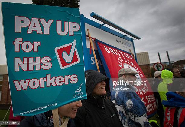 NHS staff gather at a picket line outside Southmead Hospital on October 13 2014 in Bristol England Thousands of NHS workers including nurses midwives...