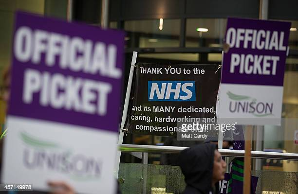 NHS staff gather at a picket line outside the Bristol Royal Infirmary on October 13 2014 in Bristol England Thousands of NHS workers including nurses...
