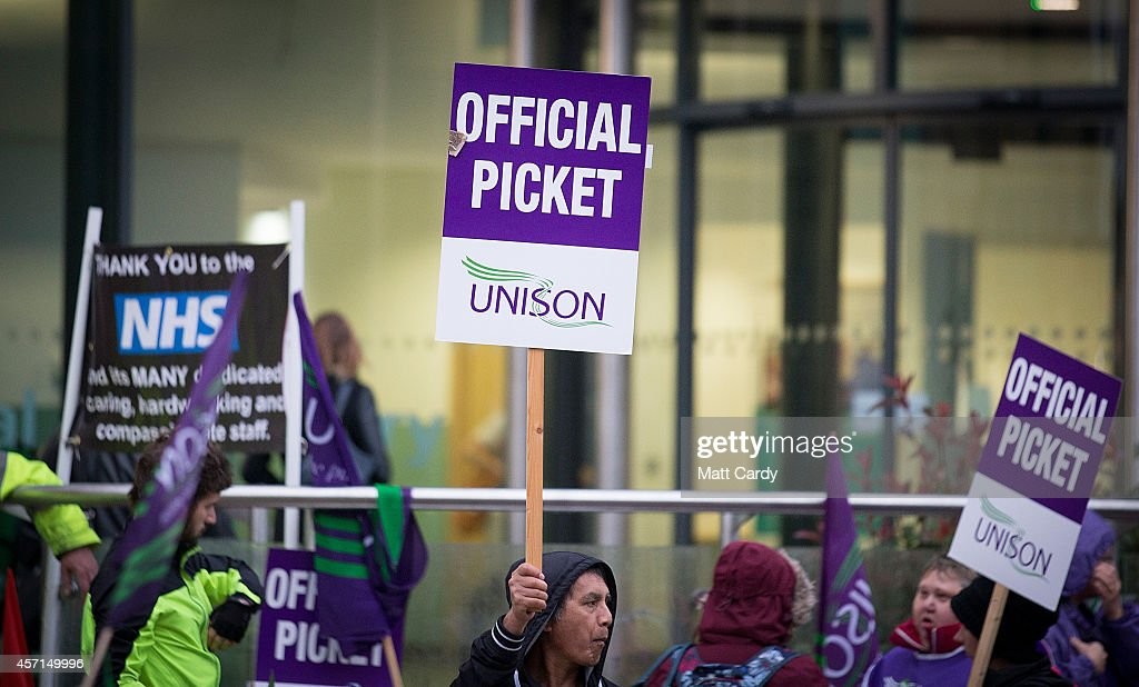 NHS staff gather at a picket line outside the Bristol Royal Infirmary on October 13, 2014 in Bristol, England. Thousands of NHS workers, including nurses, midwives and ambulance staff, have begun a four-hour strike - the first strike by NHS staff over pay in more than 30 years.