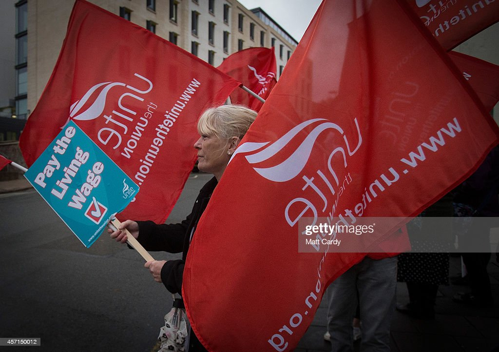 NHS staff gather at a picket line outside the St Michael's Hospital on October 13, 2014 in Bristol, England. Thousands of NHS workers, including nurses, midwives and ambulance staff, have begun a four-hour strike - the first strike by NHS staff over pay in more than 30 years.