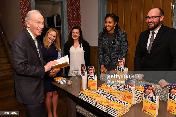 IRC staff giving away copies of 'Rescue Refugees and the Political Crisis of Our Time' books at 'This is Home A Refugee Story' New York Premier...