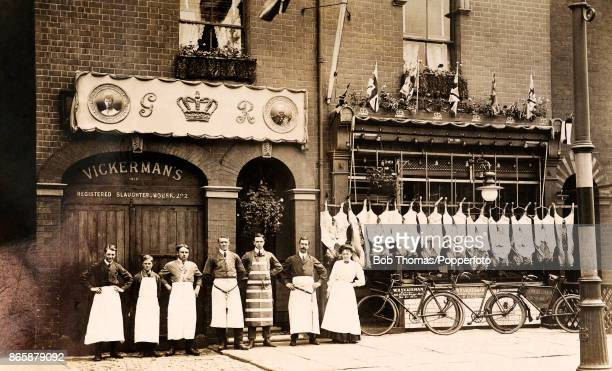 Staff in aprons pose outside the storefront of Vickermans slaughterhouse and butcher shop at 208 Newland Avenue in Hull England circa 1911 The...