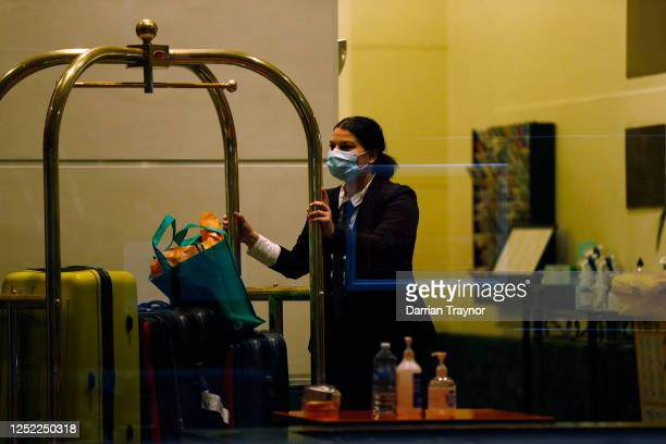 Staff inside the Stamford Hotel in Melbourne are seen moving luggage for guests in quarantine on June 25 2020 in Melbourne Australia Victorian...