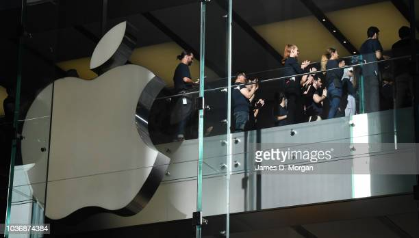 Staff inside the store are briefed before opening the doors for the Australian release of the latest iPhone models at the Apple Store on September 21...