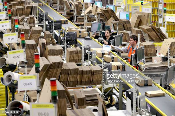 Staff label and package items in the onsite dispatch hall inside one of Britain's largest Amazon warehouses in Dunfermline Fife as the online...