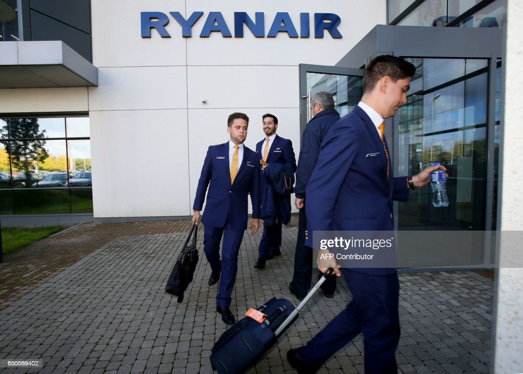 Staff leave Ryanair headquarters at Airside Business Park in Dublin on September 21, 2017. Ryanair chief executive Michael O'Leary on September 21, 2017, said he could not rule out axing more flights, but added any additional cancellations would not be linked to ongoing pilot roster problems. / AFP PHOTO / Paul FAITH