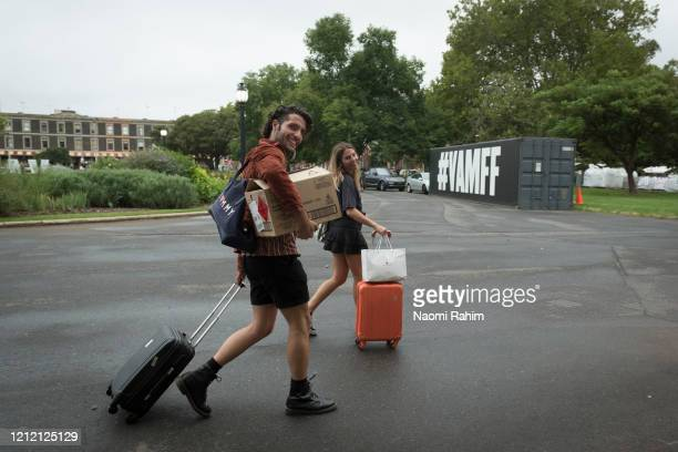 Staff leave the Royal Exhibition Building on March 13 2020 in Melbourne Australia Melbourne Fashion Festival organisers announced on Friday afternoon...