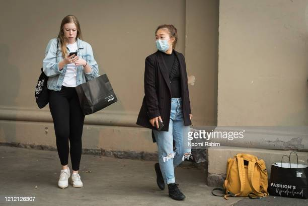 Staff leave the Royal Exhibition Building upon announcement of the cancelled Melbourne Fashion Festival on March 13 2020 in Melbourne Australia...