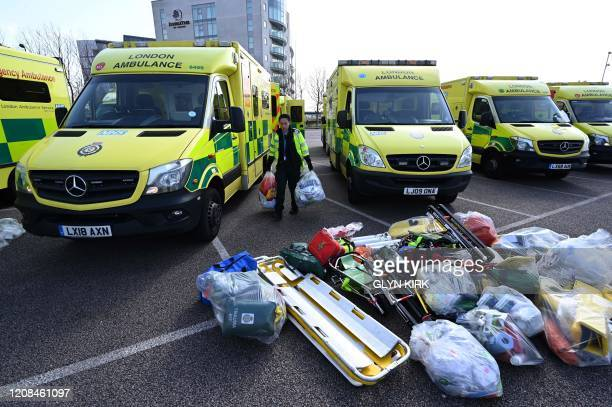 Staff load equipment into London Ambulance Service vehicles in the east car park at the ExCeL London exhibition centre in London on March 28 that is...