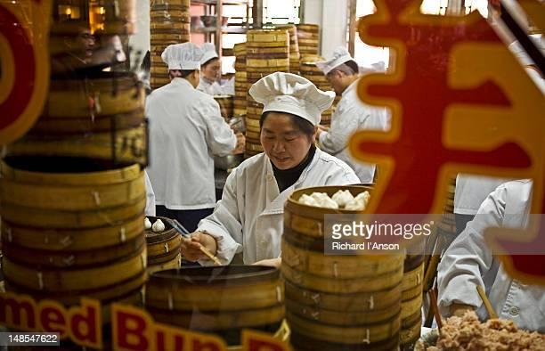 Staff making dumplings at restaurant in Yuyuan Bazaar in Old Town.