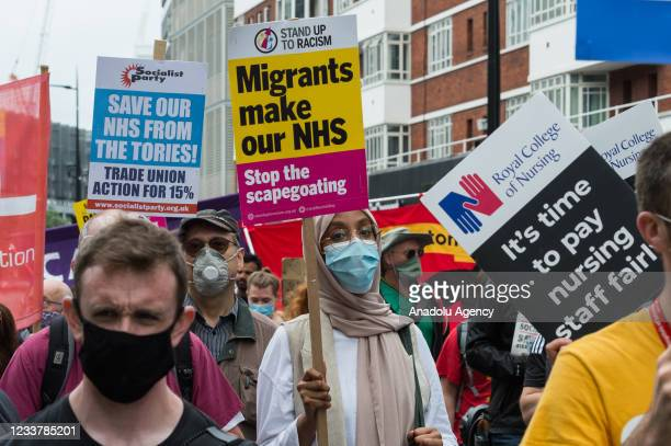 Staff march through central London during a protest demanding a 15% pay rise for healthcare workers, focus on patient's safety and an end to...