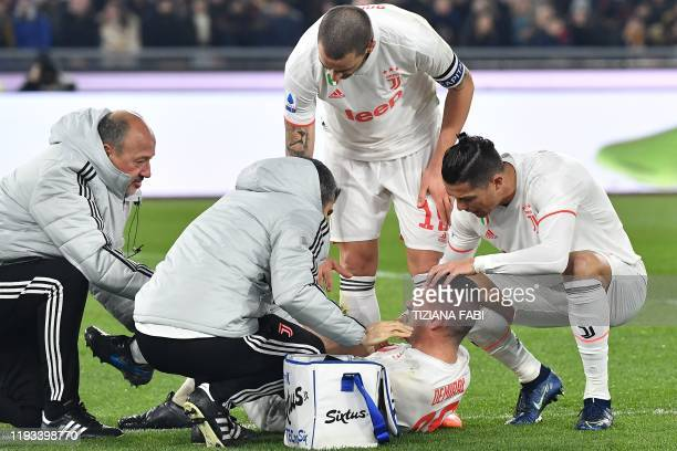 Staff medics Juventus' Italian defender Leonardo Bonucci and Juventus' Portuguese forward Cristiano Ronaldo tend to Juventus' Turkish defender Merih...