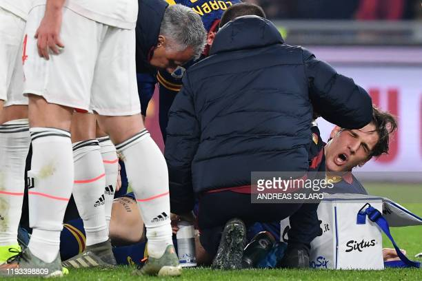Staff medics tend to AS Roma's Italian midfielder Nicolo Zaniolo after he was injured during the Italian Serie A football match AS Roma vs Juventus...