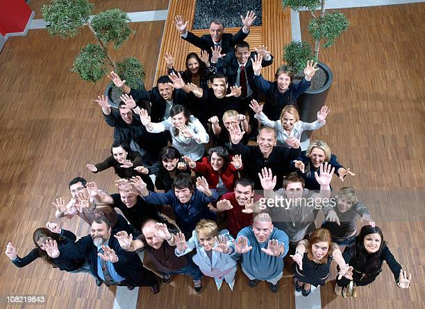 staff meeting - human pyramid stock photos and pictures