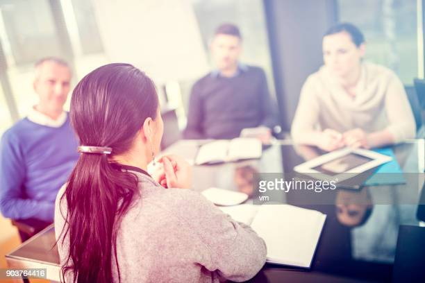 staff meeting - soft focus stock pictures, royalty-free photos & images