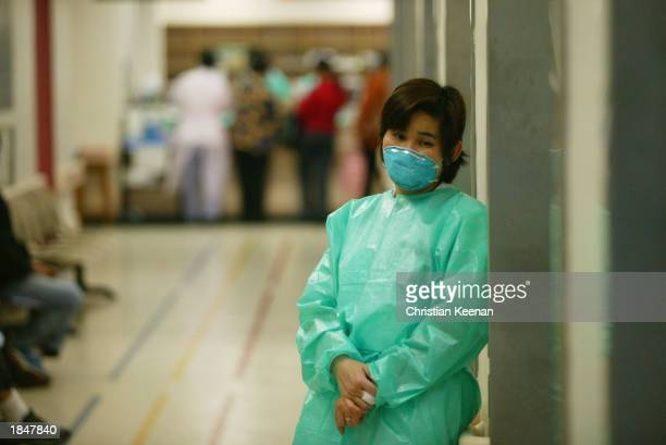 Staff member at the Prince of Wales hospital wears a face masks in an effort to protect herself from a deadly and contagious respiratory virus March...