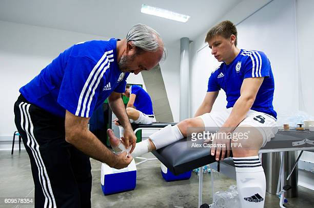 A staff member bandages the ankle of Serik Zhamankulov of Kazakhstan in the dressing room before the FIFA Futsal World Cup Round of 16 match between...
