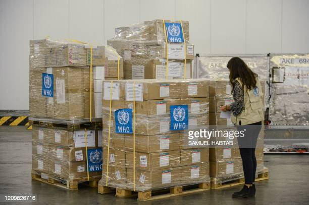 Staff member checks boxes of mostly personal protective equipment for the World Health Organization at Ethiopia Airlines' cargo facility at the Bole...